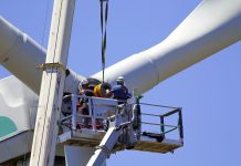 Wind energy turbine construction workers