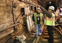 Repairing electric in PATH tunnel after Sandy