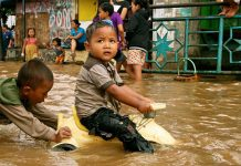 children play in floodwaters, Indonesia